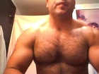 Hairy muscle god close up flexing in the AM