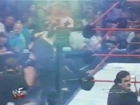 Triple H with Chyna vs. The Undertaker vs. The Rock